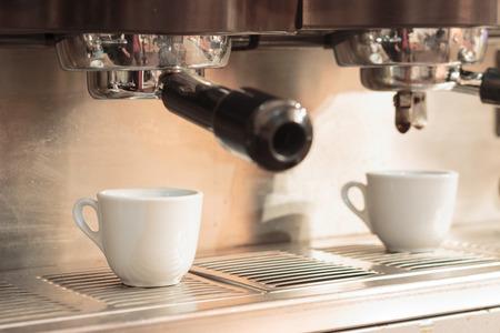 espresso machine: Espresso machine with white coffee cups