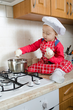 adds: Little cook adds spice to the pot of soup