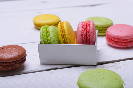 Almond cookies on a wooden white table. Colorful macaroons close up. Stock Photo