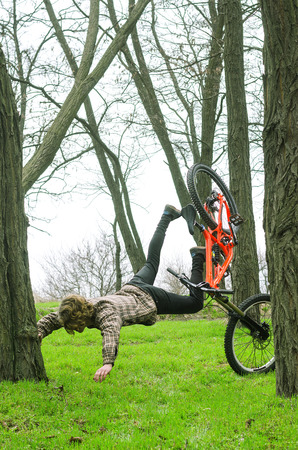 A young male extreme falls from a bicycle. A spectacular fall from a mountain bike.