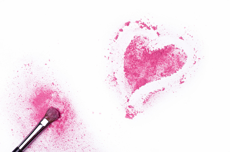 heart shaped: Heart shaped crushed eye shadows with brush isolated on white background. Pink shadows on white table, free space.