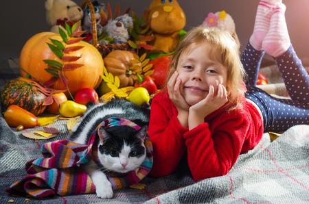 Autumn photo; little girl and cat, portrait. Autumn background. Stock Photo