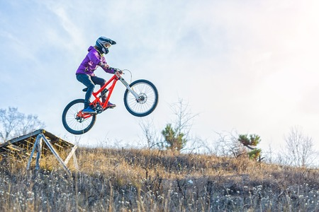 ?yclist is jumping from a high springboard, the sky and free space for your text. Extreme sports, mountain biker, mtb. Foto de archivo