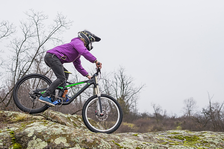 Enduro Cyclist Riding the Mountain Bike on the Rocky Trail, copy of free space. Extreme Sport Concept. Stock Photo