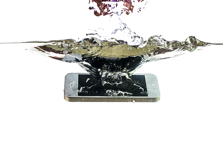 Smartphone in the water and splash on a white background. Waterproof mobile phone.