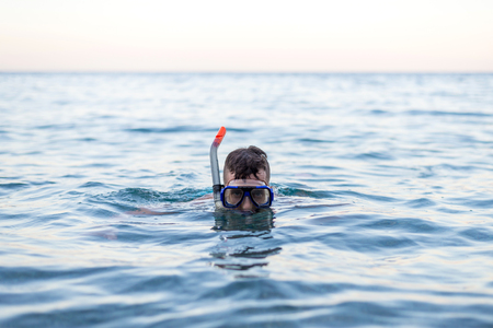 Young man swiming in a diving mask. Active lifestyle. Stock fotó