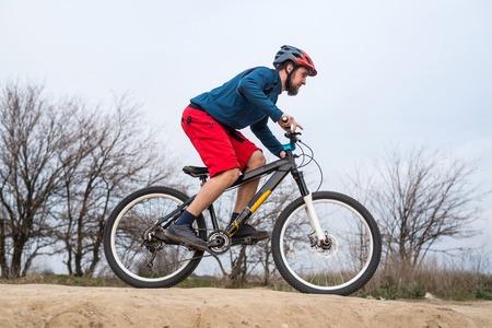 Athletic man riding a bike. Active lifestyle. Reklamní fotografie