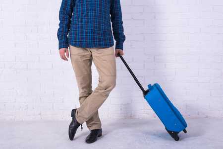 Man with suitcase near brick wall. Space for text Standard-Bild - 121482789