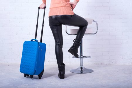 Young woman wearing casual clothes is posing at airport. Space for text. Standard-Bild - 121482792