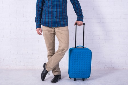 Man with suitcase near brick wall. Space for text Standard-Bild - 121482802