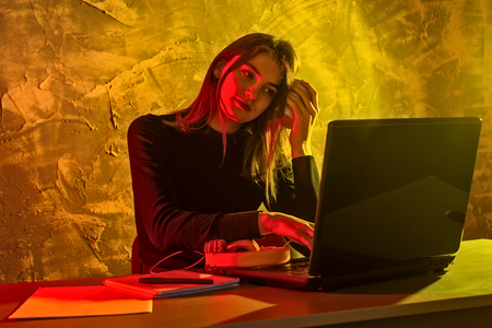 Business woman working on a laptop, stressful situation. Woman workaholic tired of excessive work.