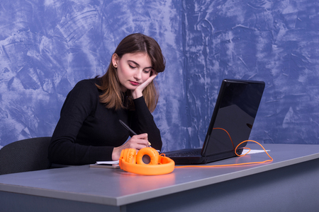 Business woman working at a laptop, remote work. Young female freelancer. Standard-Bild - 122249194