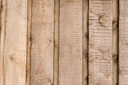 Old wooden background from natural not planed boards
