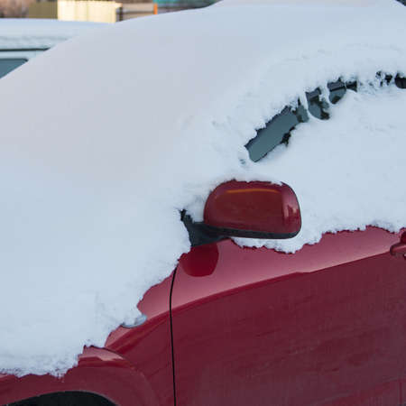 Frozen car, car windshield, glass covered with snow, front view, snow, ice, winter 免版税图像