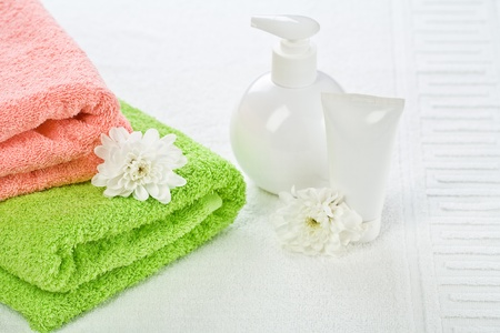 Accessories for bathing with flower on towel  photo