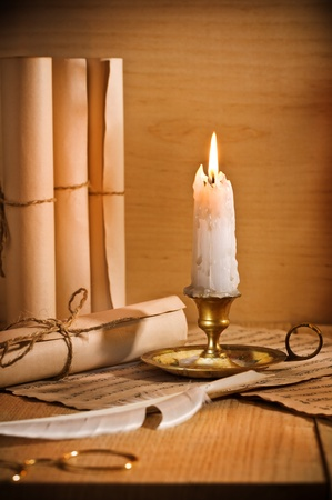 antic candle with rool of paper photo