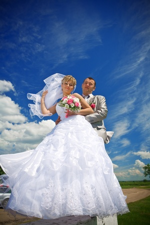 bride and groom on the sky photo
