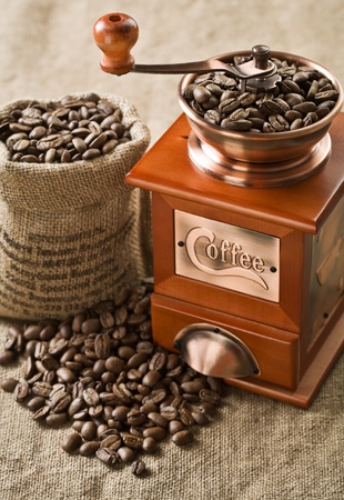 coffee beans in bag and coffee mill Stock Photo