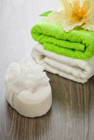 flower on towels and bath sponge photo