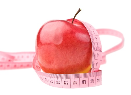 apple with measure tape photo