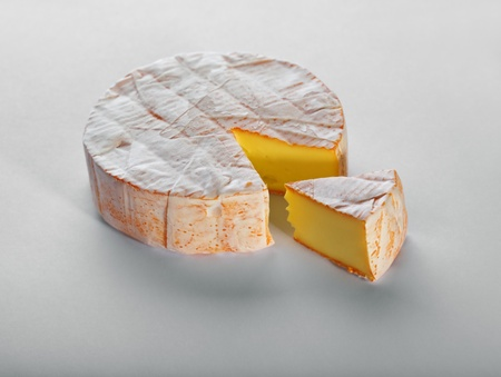 wholes: Cheese with a white mould on gray background Stock Photo