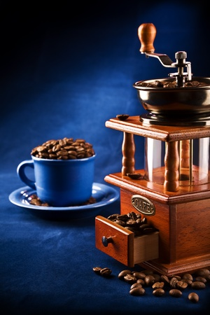 coffee spoon: composition of grinder and cup on a plate with coffee grain