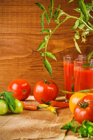 composition of tomato juice and tomato with peper photo