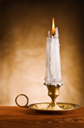 candle holder: copy space image of ablaze candle in old candlestick Stock Photo