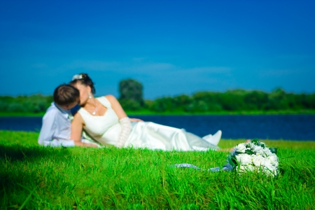 Newly married on a grass Stock Photo