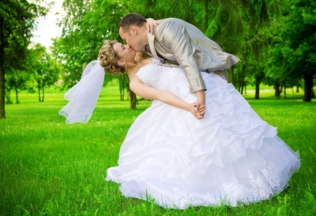 adulation: newlywed kises in the green park