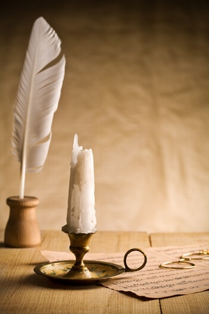 Not burning candle on vintage table Stock Photo - 11503564