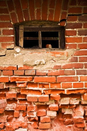 old window in a old brick wall photo