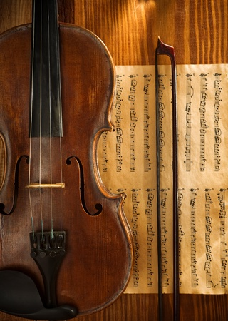 still life: violin and fiddlestick on note