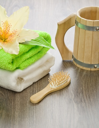 bath accessories on wooden background photo