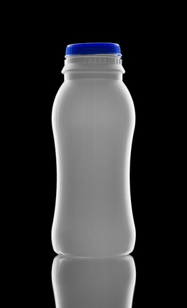 bottle on a balack background isolated photo