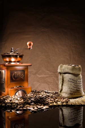 miror: mill and bag with coffee beans Stock Photo
