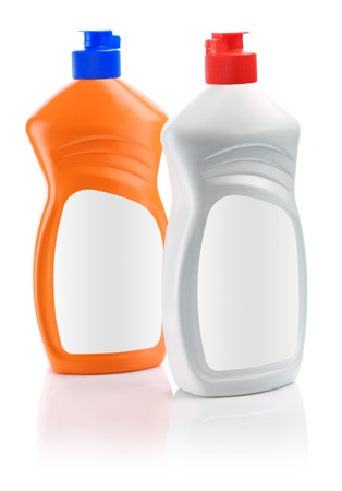 packaging equipment: orange and white cleaning bottles Stock Photo