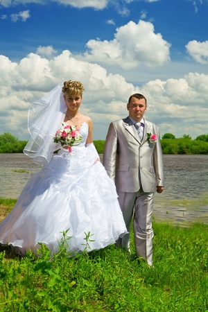 Wedding pair on coast of the river photo