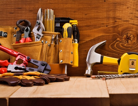 home improvement store: set of working tools on board backgroumd