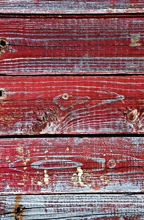 The old boards painted in red color