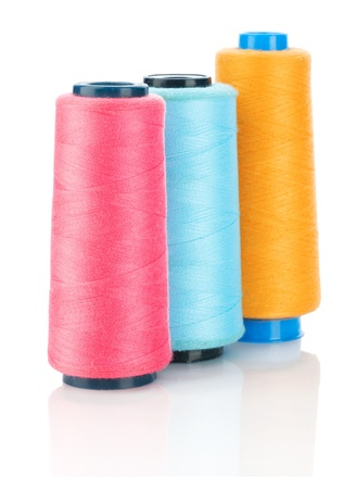 three spool of thread photo