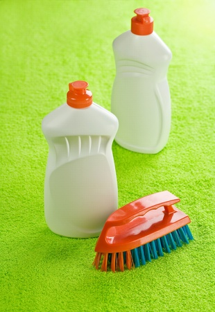 two cleaner bottles and brash Stock Photo