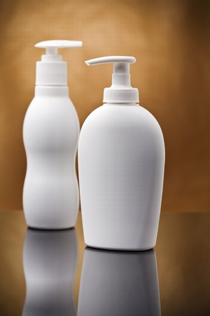 two white cosmetical sprays photo