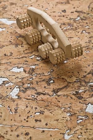 massager: wooden massager on cork wood