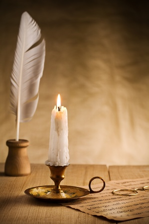 burning candle in vintage candlestick photo