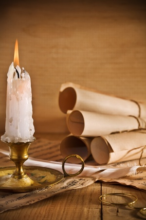 candle and old roll of paper photo