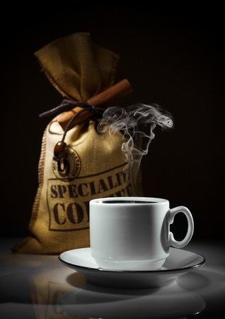 composition of white cup and sack of coffee beans Stok Fotoğraf
