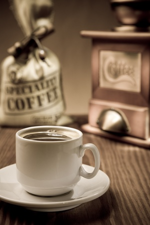 cup with coffee and accessories photo