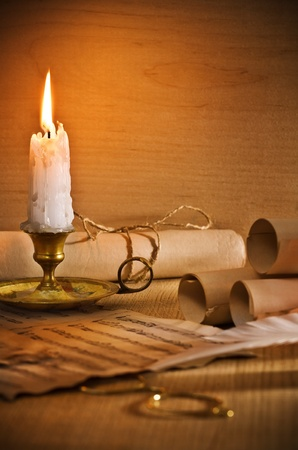 flaming candle and antic musical notes photo