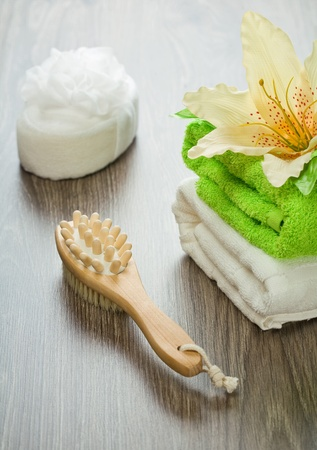 flower on towels bath sponge massager and brush photo